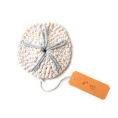 Check out this sweet crocheted sand dollar by Jessica Polk. You can find it on The Curiosity Shoppe . photo via The Curiosity Shoppe ...