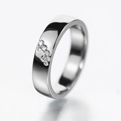 Modern diamond wedding band. The diamonds are climbing on the ring band like little bubbles.