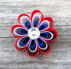 Red, White, and Blue Patriotic Flower Ribbon Sculpture Hair Clip - Fourth of July Bows - Toddler Hair Clips... Free Shipping Promo. $3.75, via Etsy.