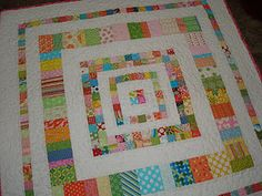 Pretty scrappy quilt by Quiltin' Like Crazy.