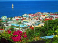 Roseau, Dominica, I stood at this very spot, during my time in beautiful Dominica. The children will try and sell you chiclet gum for money.