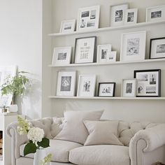 All white picture frame arrangement \ decor \ home decor \ interiors \ living room