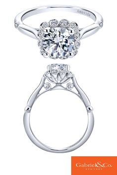 Stunning and flawless 18k White Gold Diamond Halo Engagement Ring by Gabriel & Co. This unique and lovely engagement ring has such beautiful details and designs. Check out more of our gorgeous engagement rings at www.gabrielny.com