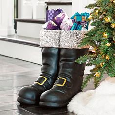 Oversized Santa Boots, such a cute idea for surprising the little ones at Christmas. You can leave them empty, fill them with seasonal accents, or shake up your Christmas morning routine by stuffing them like a stocking. #ad #christmas #christmasdecorations #Santa #holidays #boots #decor #ideas