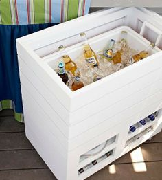 Keep beverages cold without buying an outdoor refrigerator. This wood container looks much better than a standard plastic cooler, and it matches its surrounding decor. The box offers storage space for additional beverages and dinnerware in shelves below, and it can roll into the adjacent sitting area or inside for a refill or during cold weather.