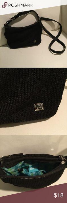 Black SAK Purse Black purse with blue lining. Small size. The Sak Bags