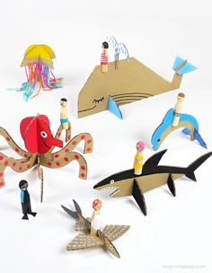 Cardboard sea creatures with free printables (via http://www.mrprintables.com/peg-dolls-with-cardboard-sea-creatures.html)