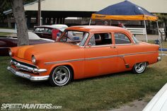 Here's a mild take on a '54 Ford done in satin orange. The ride height is low but not extreme, giving it the vibe of a car you might see in ...