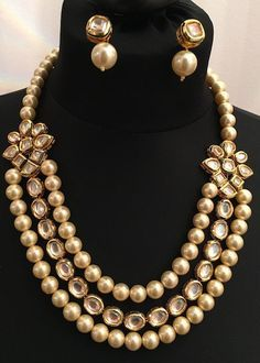 This luxurious necklace set is made with finest quality kundan and pearls. The kundan work is hand crafted with hand painted meenakari work. Earrings are included in this set.
