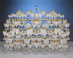 This superlative 128-piece cut crystal service is the work of the renowned house of Baccarat. Comprising glasses for red and white wine, champagne and water, as well as serving decanters, this grand service is