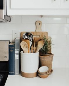 Utensil Crock Collection – diy kitchen decor on a budget Van Kitchen, Home Decor Kitchen, Home Kitchens, Kitchen Design, Kitchen Ideas, Decorating Kitchen Counters, Rental Kitchen, Island Kitchen, Kitchen Themes