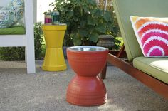 We're in the middle of summer now, but many stores are already marking down their outdoor and patio products. If you see a pair of large, inexpensive flower pots you like, grab them. No, they aren't for plants this time. If you add a dollar store pizza pan on top, you can make an awesome, sculptural side table that works both indoors and out.