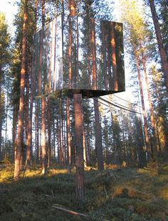 Unique tree hotel covered in mirrored glass was recently opened in Sweden.  Designed to be accessed by a rope bridge, the Mirrorcube suite comes with a double bed, small bathroom, and a terrace on the roof.    To prevent birds from colliding with the treehouse, the glass was laminated with infrared film that only birds can see.
