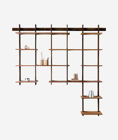 """The Sticotti bookshelf is an ingenious, one-of-a-kind wooden modular shelving system that hangs from a single wall-mounted bracket. The shelves join together with a precise interlocking system and can be customized to fit any space by combining bracket systems and adding more shelves, making the possibilities endless. Details: 81.5""""W x 79.5""""H x 11""""D Made up of: Kit B + Kit C Struts are constructed from solid ipe wood; shelves are made of cedar veneered MDF Weight tested for up to 390 pounds Plea Diy Dvd Shelves, Shelves In Bedroom, Floating Shelves Diy, Built In Shelves, Wall Shelves, Modular Walls, Modular Shelving, Modern Shelving, Diy Wooden Wall"""