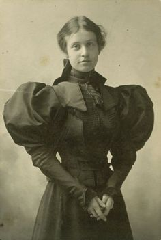 This is a girl in 1897 whose father died. Her puffy sleeves signify that she is in the early stages of mourning.  My Ear-Trumpet Has Been Struck By Lightning