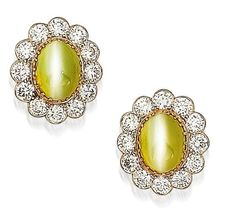 A pair of cat's eye chrysoberyl and diamond earrings
