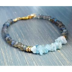 Gorgeous 'A' grade labradorite gemstone beads & ice blue aquamarine gemstone chip beads. Finished with gold filled findings, lobster clasp & ring, and chain extender. Design to fit most wrists.