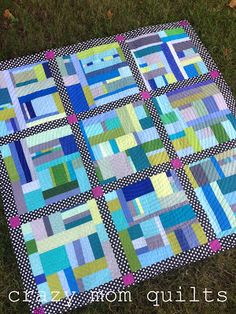 Fun improv style quilt.  Like how the borders help tie it together.  From crazy mom quilts: out of my box quilt