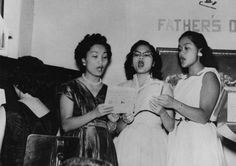 These three women wearing their Sunday Best are singing at the Father's Day Banquet at the Filipino Christian Church in Los Angeles, California in 1955.