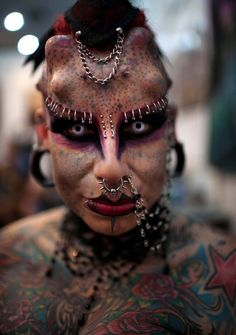 """Umm.... """"She says she became interested in expressing herself through piercings and tattoos as a way of recovering from the trauma of abuse and now uses her appearance to help raise awareness and help other victims."""""""