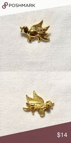 Vintage Gold Bird Brooch Vintage gold bird brooch has a blue rhinestone eye. Excellent condition. Jewelry Brooches
