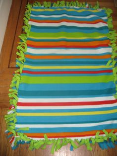 How to Make a Tie Fleece Blanket....might make one for a grad gift using USMC fleece