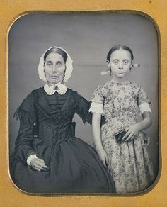"""Grandmamma's dress is lovely, but, if you look closely, her eyes are even lovelier. Too bad she didn't relax her face. As for granddaughter she would have been perfect for the """"Our Gang"""" comedies that were 80 years in the future....1840s."""