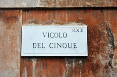 I like how they put up street signs in Rome.. good in the day.. not so good in the night though.