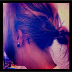 I want this cross tattoo behind my ear. I like that you can show it when you want, but hide when needed.