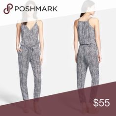 Splendid Arrowhead Print Jumpsuit XS Worn once.  Lightweight rayon jumpsuit flaunts a festive print allover. Surplice neckline. Narrow shoulder straps. Blouson top with snap button at bust. Self-tie drawstring at elastic waist. Side hand pockets. Tapered throughout ankle. Slip-on design. 100% rayon. Dry clean only. Made in the U.S.A. Splendid Pants Jumpsuits & Rompers
