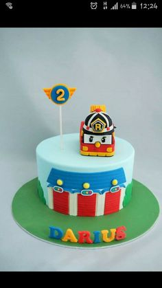 Robocar poli theme cake!! Spaces on cake board was created so mummy can put all the toys on top.