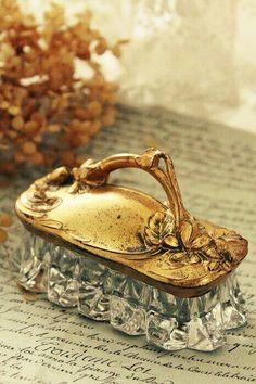 Vintage crystal jewel box with golden lid.