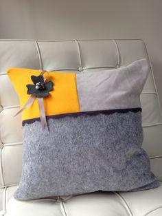 Yellow and grey leather cushion … violet daisy