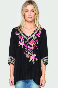 Johnny Was Leah Blouse in Black. Add whimsy to your wardrobe with the Leah Blouse! This v-neck top features a bright floral embroidery design in cheerful red, pink, yellow, and green hues on the front that is accented by geometric embroidered border designs along the neckline and sleeve cuffs. Shop for this and many more items at Emma Laura in Dublin, GA in Ivy Place Shopping Center. You can also purchase by phone at 478-272-2095 or shop our website at www.emmalaura.com.