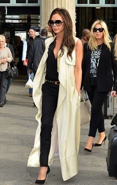 Victoria Beckham looks super chic as in a lemon sleeveless duster coat from her own SS14 collection and a black leather Saint Laurent belt <3<3 Love her pin-thin Casadei stiletto pumps ;)