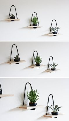 Add a minimalist touch to your interior and brighten it up with a few small plants potted in these wood and black metal mini wall planters, that are hung with a single hook.