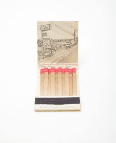 Krista Charles // Graphite drawings on matchbooks based on Google Street View photographs