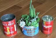 coffee cans used as planters. Spray the inside of the cans with a waterproof sealant to help keep them from rusting.