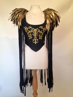 Annunaki gold feather fringed shoulder pieces by Lovechild Boudoir.