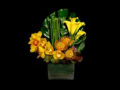 Tropical flower arrangement ofyellow Callas, Orchids and Protea's. Designed by Steven Bowles at Steven Bowles Creative, Naples, Florida. www.stevenbowlescreative.com