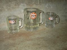 A & W Root Beer mugs.  Uncle Matt owned an A & W and we would go there on Sunday after church and bring home a gallon of Root Beer to have floats later.