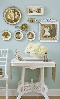 Turn your old family photos into an intriguing wall display by showing them off in vintage silver and ceramic pieces. by helga