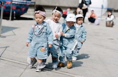 A group of young toddlers wear denim with sneakers at Seoul Fashion Week