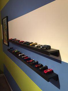 Ribba shelf from Ikea used to display Hot Wheels cars. We hung the shelf upside down.