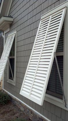 false window with louvered shutters slide bolt and faux tilt