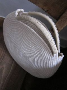 Round winter white bag made out of cotton rope and up cycled full-grain white leather. A striking monochromatic look. This bag is durable and roomy enough to fit all your necessities - measures about 12 inches across and 2 inches deep, with about 3 inch handles. Find the same cotton rope