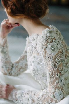 "Close up of our ""Asi"" dress with beautiful lace by Sophie Hallette. Love! #sarehnouri #lace #weddingdress"