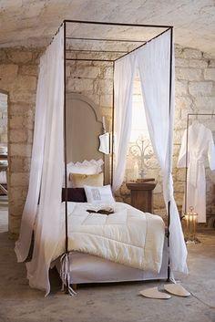 romantic 'skinny' canopy...love the white & wood & stone combo w/soft lighting