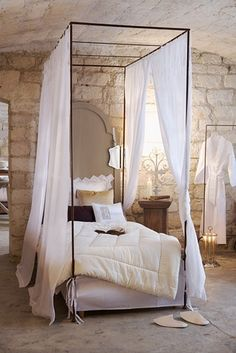 romantic 'skinny' canopy...love the white & wood & stone combo w/soft lighting
