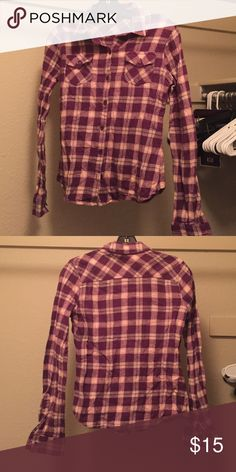 Mossimo Purple plaid flannel Purple plaid cotton flannel with pink and tan accents. Dark purple buttons. Front button close. Two breast pockets with buttons. No longer fits. Mossimo Supply Co Tops Button Down Shirts